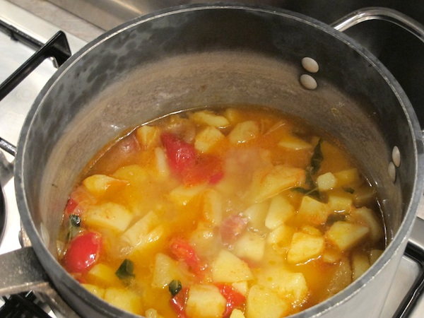 Riso e Patate - Adding the potatoes to the sauce